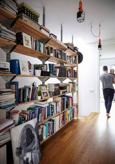 Love this bookcase wall used instead of a traditional banister in Jerzy's home  #IKEAIDEAS