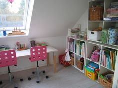 Great idea for our playroom which also has a slanting wall with sunlights. - although ours is taller.  We already have book/toy cubbies like this.