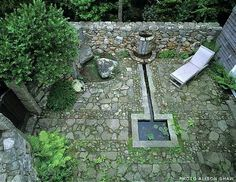 Lew French - Fountains and Water Features - shaped like a spade.