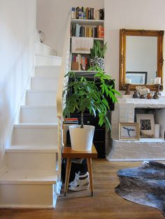 Itsy bitsy stairs leading up to a little loft area for your bed.  What a great studio apartment!