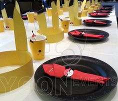 DIY. Pokemon Motif Table Setting. Handmade Pikachu Cups with hand painted and ears. DYI Pikachu Birthday Hats for every kids. Napkin Holders with Pokemon Ball Ribbon.