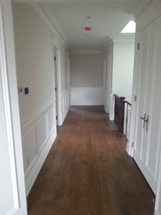 Rich and warm hardwood floors. Gorgeous wainscotting and tall doors.