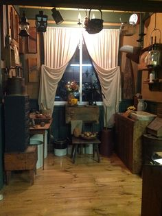 Prim Nook--I like how the curtains are tied back