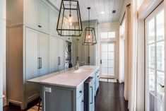 Urban Grace Interiors | House of Turquoise New Orleans Mansion, Laurel House, Utility Room Designs, Laundry Room Design, Laundry Rooms, Mud Rooms, Heart Pine Flooring, Laundry Room Inspiration, Modern Contemporary Homes