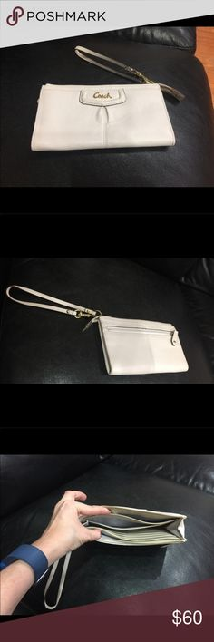 EUC Ivory Coach Wristlet Beautiful ivory wristlet, excellent used condition.  Has many compartments and can be used as a wallet, has compartments to fit many cards. Coach Bags Clutches & Wristlets