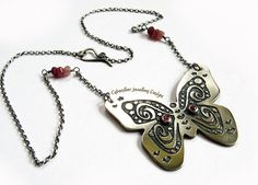 This pretty butterfly is entirely handmade by me and constructed from thick sterling silver. She measures approximately 40 mm x 37 mm and is