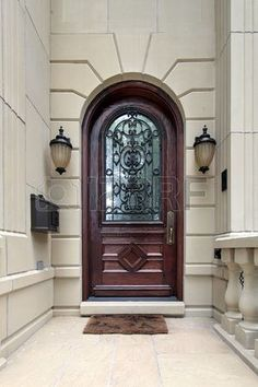 Front door of luxury home with arch
