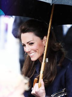 how does she manage to look like this in rainy weather?! teach us your ways. #kate #duchess