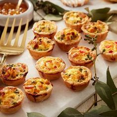 These easy to make bite-sized egg, chive and cheese mini quiche are a delicious addition to any breakfast or brunch. You can create 2 dozen at a time when you use the Wilton Mega Mini Muffin Pan, so you're ready to feed any hungry crowd anytime with this Samosas, Empanadas, Gourmet Recipes, Appetizer Recipes, Pasta Recipes, Delicious Recipes, Cooking Recipes, Apple Recipes, Ham And Cheese Quiche