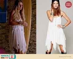 Paige's white frayed handkerchief dress on Graceland.  Outfit Details: http://wornontv.net/34196/ #Graceland