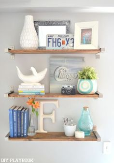 Enhance your living room or family room with fabulous DIY home decor ideas like these IKEA Hack Rustic DIY Shelves. You are going to love this rustic and industrial look, it is a simple way to add decor to any wall in your home.