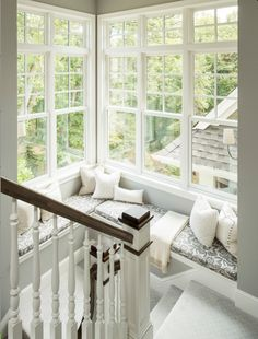 Wrap around window seat along staircase-Perfect place to curl up with a great book: