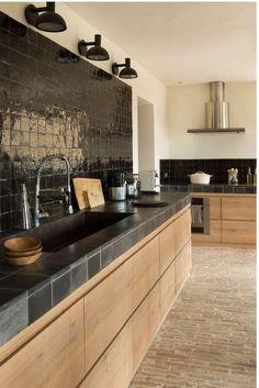 Modern kitchen Matt black tiled worktop on oak