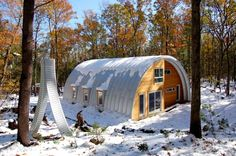 houses quonset hut home in woods