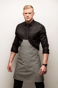 Tie-apron with a hand-tied knot and two pockets. Washable at Packed in a white cardboard gift-box. Bartender Uniform, Waiter Uniform, Chef Dress, Hotel Uniform, Restaurant Uniforms, Leather Suspenders, Leather Apron, Apron Designs, Coffee Shop Design