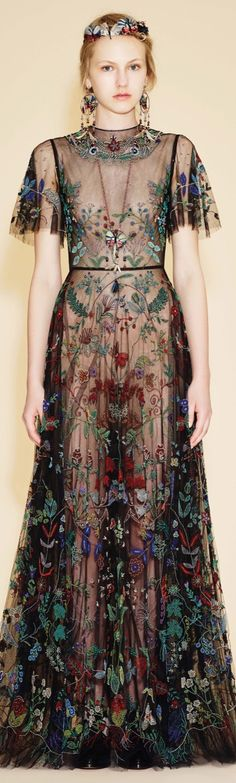 Valentino resort 2016 we love sheer with scattered large geometric, collaboration with Metis native Canadian artist we wear similar trending embroidered floral or Bird of Paradise appliqué and prints, we r wearing,higher necklines trend buttoned up w sheer, love wearing Native American made artwork, see Oscar dress for The Reverent costar wearing version of this too!!!