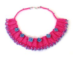 Pink Crochet Necklace with blue crochet flowers by hobitique