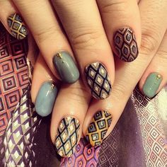 The whole mani would be too busy for me (though it looks gorgeous, no argument!), but those triangles? I WANT to do those!