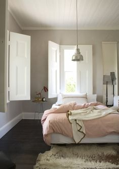 Love the cowhide with the grey walls and red and white striped comforter...