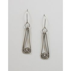 Sterling silver woven wire dangle earrings.  The earrings are hand crafted using sterling silver wire and have been hammered, sanded and polished.  The swirl design has been specifically designed to f