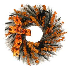 Bring festive style to your doorway with this Halloween wreath, featuring furry spiders, orange eucalyptus, black wheat, and matching ornaments. ...
