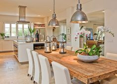 {dining room and kitchen space, open plan - LOVE that rustic wood table}