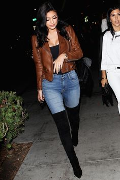 Camel fitted leather jacket x black tucked in tank x high wasted light wash jeans x black knee high boots.