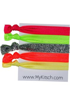If you've got hair that can be tied up, tie it up. These elastics don't pinch and pull and really stay put — plus, they look cute stacked up on your wrist if you want to bring extras!     Kitsch Electric Hair Tie, $12, available at Swell.