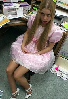 It was bring your daughter to work day and mom didn't want to be left out so here I am inher office dressed like a sissy girl!! Some of the guys here are even flirting with me!