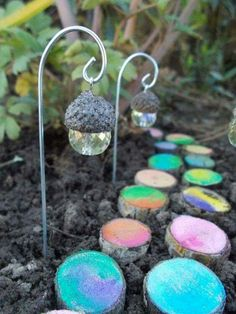 ACORN CRYSTAL FAIRY LIGHTS....with a PAINTED LOG WALKWAY! This is such a cute idea for a Garden....love it! Featured on our BEST Garden Ideas!  http://kitchenfunwithmy3sons.com/2016/03/the-best-garden-ideas-and-diy-yard-projects.html/