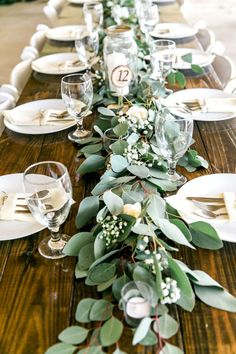Long Feasting Table with Garland Greenery Centerpieces and Wooden Farm Tables Rustic, Country Wedding Reception Decor Inspiration Greenery Centerpiece, Greenery Garland, Garland Decoration, Centerpiece Wedding, Rustic Table Centerpieces, Greenery Decor, Centerpiece Ideas, Short Centerpieces, Branch Centerpieces
