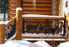 Exterior #Railing of Deer is stunning on this log home front entrance. Powder-coated steel designed any way you like it.  Visit NatureRails.com and check out our photo gallery of designs. We ship across the US and Canada.  Made in USA by local artists that work in metal.