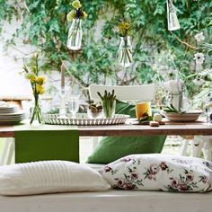 Use textiles and cushions to bring indoor coziness and soften your outdoor-inspired set-up.