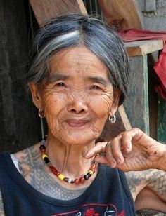 """Whang Od In a small village called Buscalan in Kalinga, The Philippines A woman called Whang Od is possibly the last of her kind. At a sprightly 97 years of age she is keeping alive the traditions of her ancestors, the tradition is called """"Batok"""" and is the art of tattooing.  Tattooing has been practised in the Philippines for centuries, however the arrival of Spaniards, Americans and Christianity led to the decline and almost extinction of indigenous tattooing."""