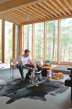 McMinn, an architect, helps Soren construct a TinkerToy tower. The cowhide rug is from Perfect Leather Goods, and the Wassily Chair is by Marcel Breuer for Knoll.