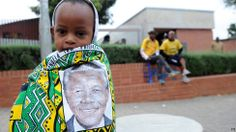 A child draped in a cloth with the image of former South African president Nelson Mandela, stands outside his former home, now museum, in Soweto, South Africa First Black President, Black Presidents, Nelson Mandela, People Art, Young People, Black Is Beautiful, Cool Photos, Amazing Photos, South Africa