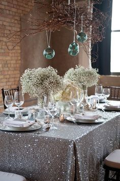 love the table cloth. baby's breath flowers. and hanging bulbs