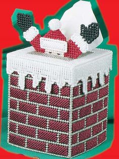 Christmas tissue box - plastic canvas.  This is a cute one.