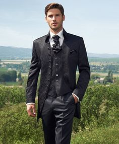Extravagant 8-button long jacket with a modern cup collar in black. The jacket and the waistcoat are made of a modern, fantasy jacquard fabric. The trousers are made from a plain fabric.