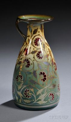 Pilkington's Royal Lancastrian Pottery Vase, England, c. 1909, bottle shape with single side handle, lustrous glaze and with red enameled flowers among scrolled lustre foliage to a yellow and green ground, artist monogram for William Mycock and impressed mark.