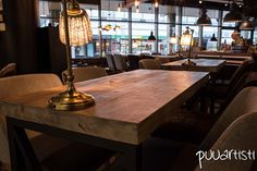 Reclaimed wood cafe tables. Design by Nurkanvaltaajat. Woodwork by Puuartisti.