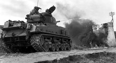 A Sherman Flamethrower (M4A3R3) tank in action, 1944.