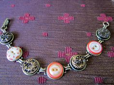 Tangerine orange antique button bracelet, 1800s china buttons, intricate black glass buttons with gold accenting