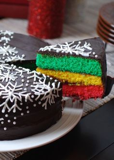 The best and original Italian Rainbow Cookie Cake recipe by Alejandra Ramos of Always Order Dessert. A full-size cake version of the classic Italian-American cookie. Made with almond paste and raspberry filling.