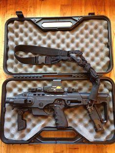 Pistol to carbine conversion is still a pistol not a SBR, but she sure looks… Weapons Guns, Guns And Ammo, Paintball, Submachine Gun, Fire Powers, Cool Guns, Assault Rifle, Self Defense, Tactical Gear