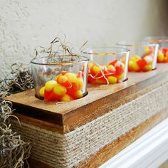 Just try to keep your fingers off this yummy mantel display. Fill a fall-theme votive holder with candy corn instead of candles and surround with Spanish moss. Designer: Alysha Cauffman, howdoesshe.com