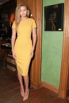 Mustard yellow is definitely Gigi's color! The supermodel chose a fitted short sleeve cocktail dress in the shade for the Americans in Paris party, completing her outfit with nothing but a pair of patent-leather taupe pumps.