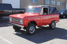 Ford Bronco red with black top