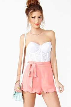silky coral shorts with high belted waist and scalloped hem