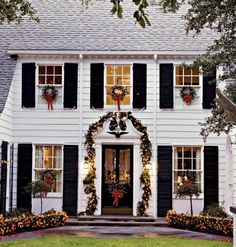 holiday decor...window wreaths and lit garland